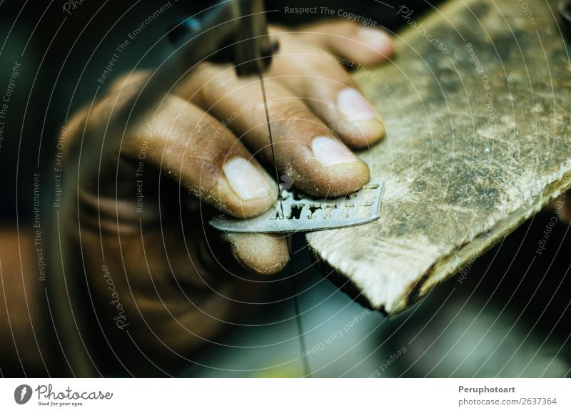 man's hands goldsmith work on a piece of silver Design Handicraft Work and employment Profession Workplace Industry Craft (trade) Tool Saw Human being Woman