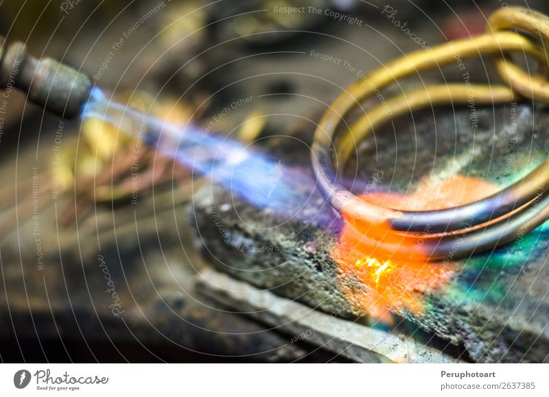 Close-up of jewelry welding with blowtorch. Luxury Design Work and employment Profession Industry Craft (trade) Tool Man Adults Hand Jewellery Metal Make