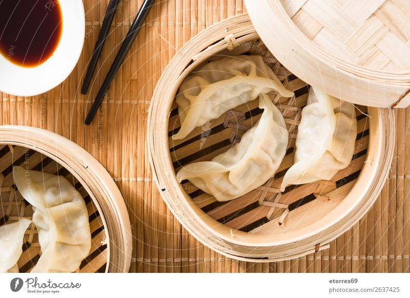Dumplings or gyoza served in traditional steamer Japanese Chinese Oriental Food Healthy Eating Food photograph Tradition Soja-bean sprout Soy bean Meal Asia