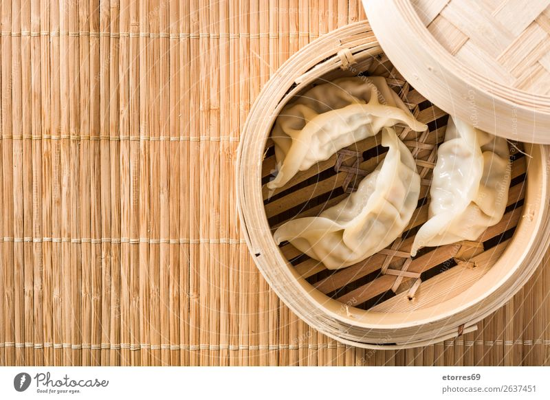 Dumplings or gyoza served in traditional steamer Japanese Chinese Oriental Food Healthy Eating Food photograph Tradition Soja-bean sprout Soy bean Meal Asians