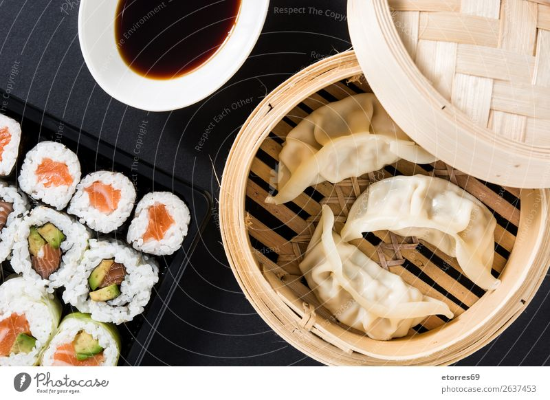 Dumplings or gyoza served in traditional steamer and sushi Sushi Vegetable Fish maki Food Healthy Eating Food photograph Rice Roll Seafood Tuna fish Salmon