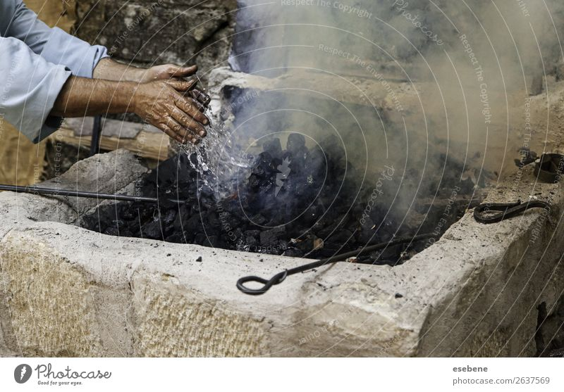 Turning off flames with water in the coal Lunch Beautiful Work and employment Hand Old Fresh Hot Natural Black White Protection Colour Testing & Control