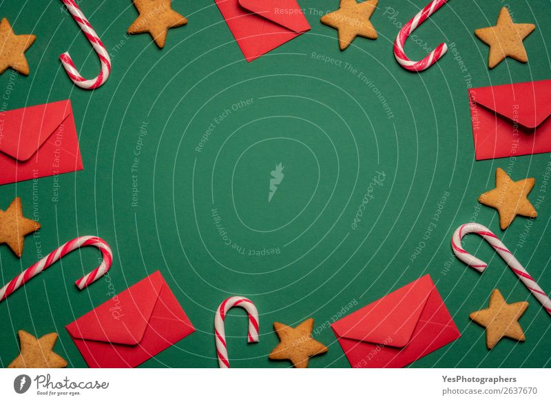 Background with envelopes, lollipops and gingerbread cookies Christmas & Advent Green Red Winter Feasts & Celebrations Copy Space Symbols and metaphors