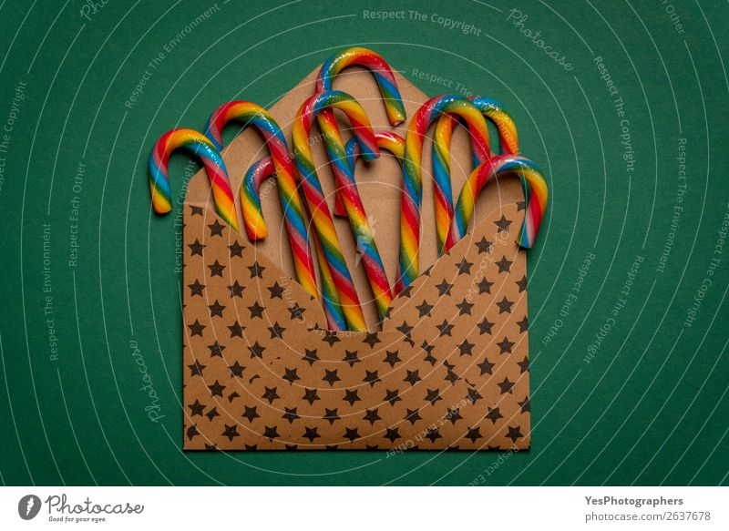 Multicolored candy canes in an open envelope Candy Winter Feasts & Celebrations Christmas & Advent Birthday Paper Brown Green Colour Tradition above view