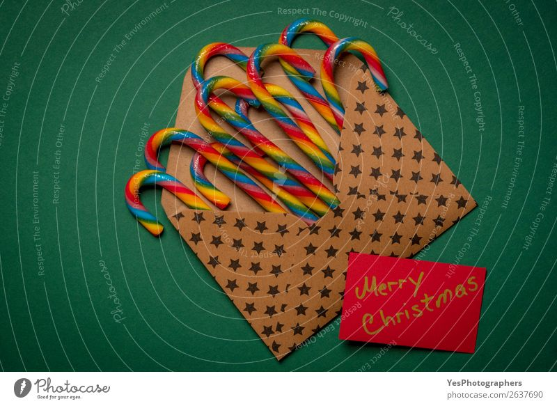Rainbow candy canes and Merry Christmas message Candy Winter Feasts & Celebrations Christmas & Advent New Year's Eve Paper Brown Green Colour Tradition