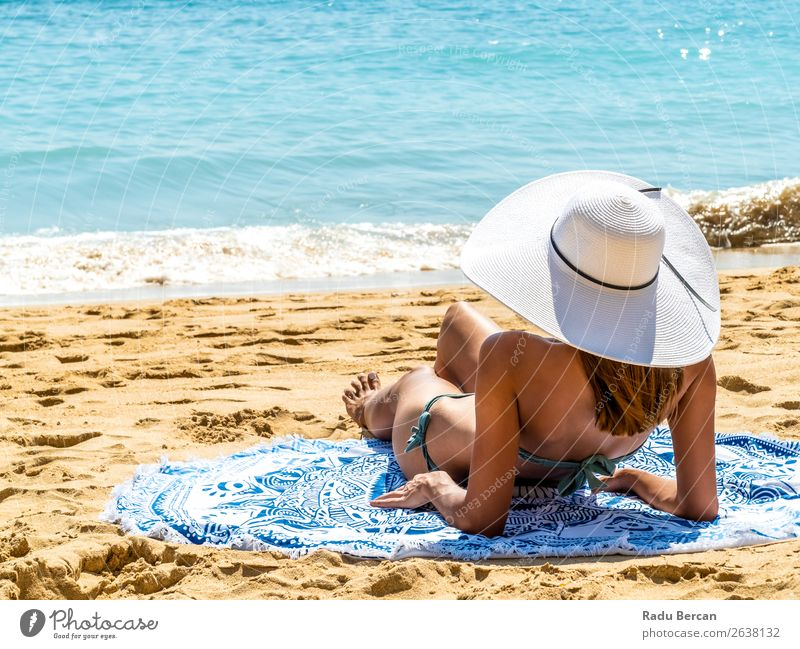 Young Woman With White Hat Relaxing On Ocean Beach Sand Youth (Young adults) Girl Fashion