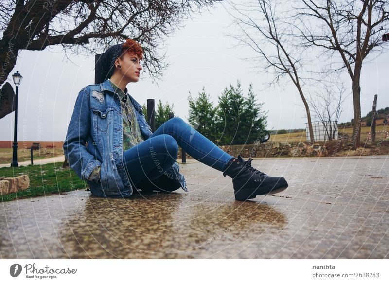 Young redhead woman alone in a village in a rainy day Woman Human being Youth (Young adults) Young woman Loneliness Calm Winter 18 - 30 years Lifestyle Adults
