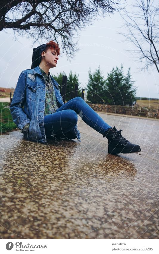 Young redhead woman alone in a village in a rainy day Woman Human being Youth (Young adults) Young woman Loneliness Winter 18 - 30 years Lifestyle Adults Autumn