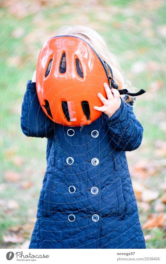 Girl with red bicycle helmet Cycling tour Human being Child 1 3 - 8 years Infancy Stand Blue Green Red Bike helmet To put on Helmet Protection Road safety