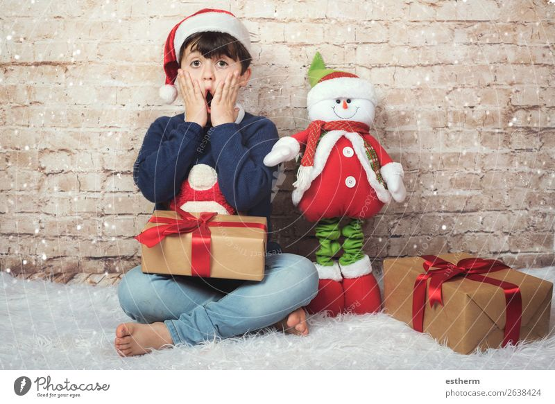surprised child on christmas Child Human being Christmas & Advent Joy Winter Lifestyle Funny Emotions Movement Laughter Feasts & Celebrations Boy (child)