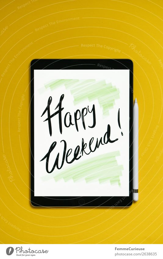 "Tablet with a handwritten ""Happy Weekend!"" on yellow background Technology Entertainment electronics Advancement Future Creativity Have a nice weekend Desire"