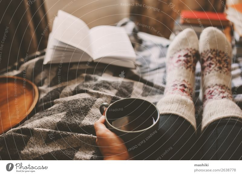 cozy winter day at home with cup of hot tea Tea Lifestyle Relaxation Leisure and hobbies Reading Winter House (Residential Structure) Woman Adults Feet Book