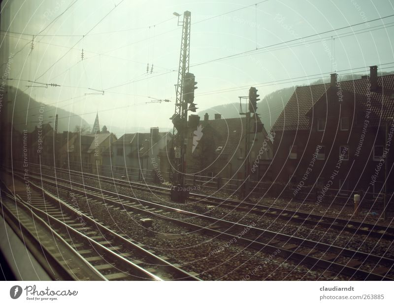 Vacation & Travel House (Residential Structure) Mountain Germany Train window Transport Speed Driving Railroad tracks Traffic infrastructure Train station High voltage power line Express train Church spire Switch Vignetting
