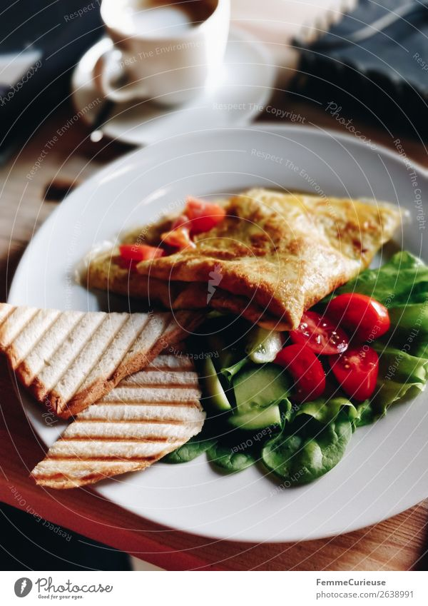 Delicious breakfast in a café: omelet, salad and toast Food Nutrition Breakfast Organic produce Vegetarian diet Diet To enjoy Omelette Toast Lettuce Tomato Café