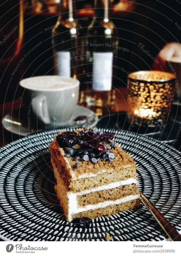 A delicious piece of cake on a plate in a café Food Nutrition To have a coffee Organic produce To enjoy Cake Cream Candlelight Cozy Decoration Coffee Coffee cup
