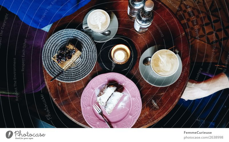 Top view of a table in a café Lifestyle To enjoy Coffee To have a coffee Coffee cup Cake Baked goods Dessert Café Afternoon Eating Candle Cozy Wooden table