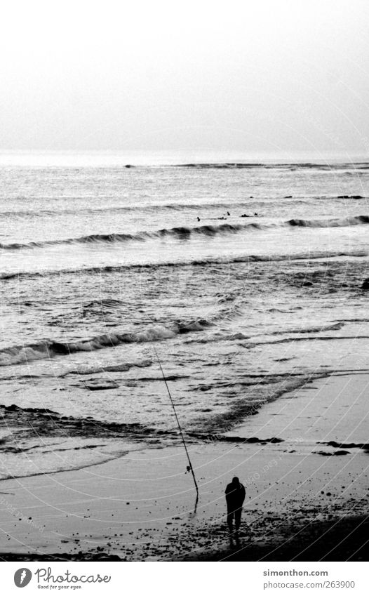 anglers 1 Human being Infinity Fishing (Angle) Fishing rod Spoon bait Deep-sea fishermen Fisherman Ocean Coast Loneliness Man Patient Black & white photo