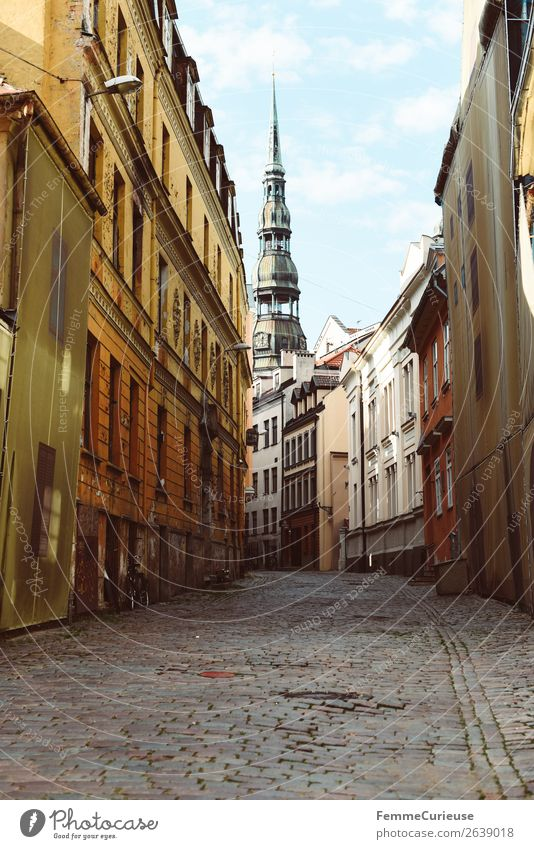 Lane in Riga with view to the Petri church Town Capital city Culture Travel photography Latvia Svētā Pētera baznīca Sightseeing Paving stone