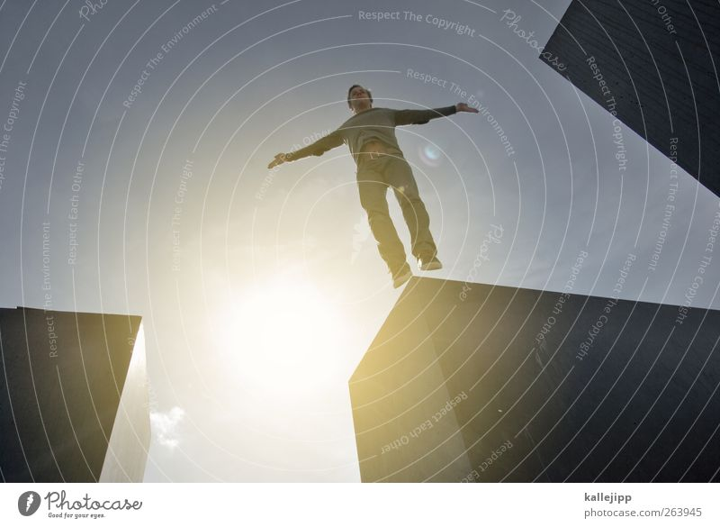 no jump zone Human being Masculine Man Adults Life Body 1 Monument Jump Holocaust memorial Block Colour photo Exterior shot Light Shadow Contrast Silhouette