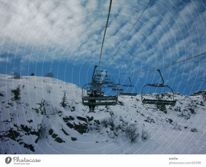 Lift to the sky Skis Ski lift Clouds Altocumulus floccus Mountain skift Sky Blue