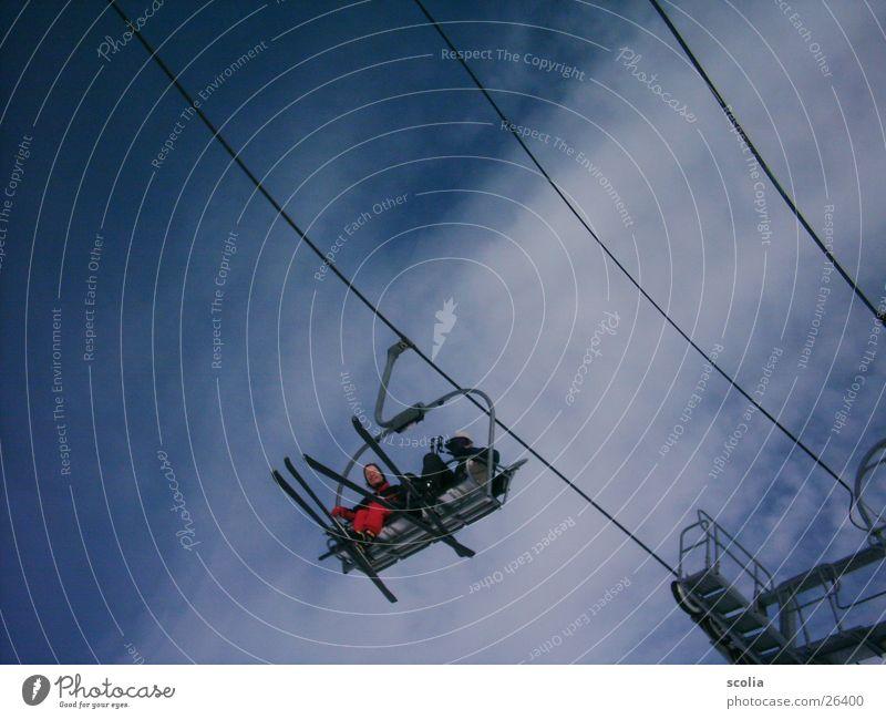 ski flying Skis Ski lift Clouds Air Armchair Sports skift Sky Blue Flying