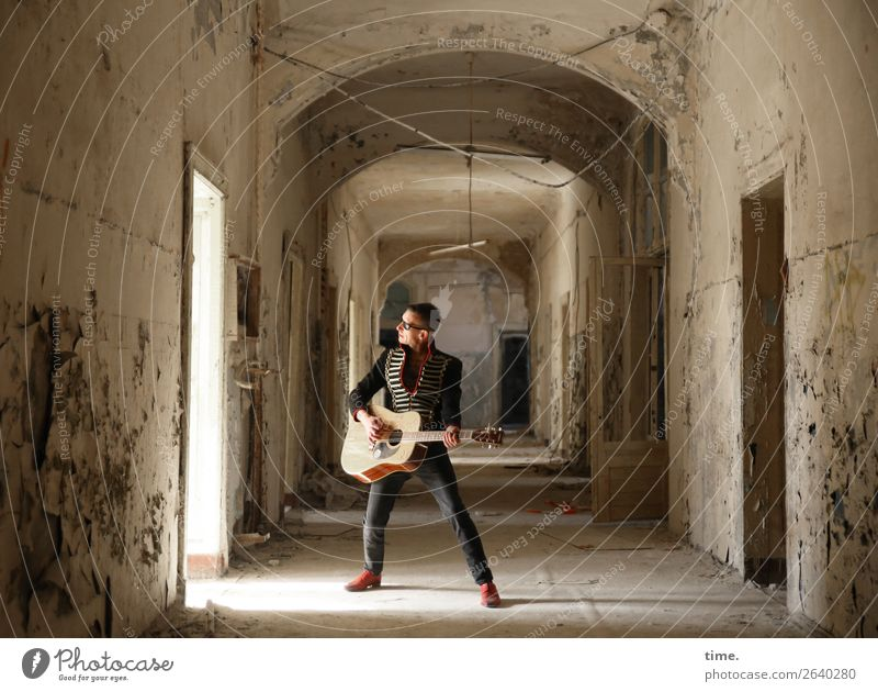 GuitarMan Masculine Adults 1 Human being Music Musician Dream house Ruin lost places Wall (barrier) Wall (building) door Hallway Jacket Sunglasses Brunette