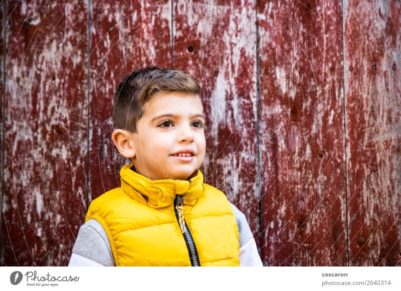 Little kid with a yellow vest in front of an old red door Child Human being Old Colour Beautiful Red Loneliness Joy Face Wood Yellow Natural Happy Style