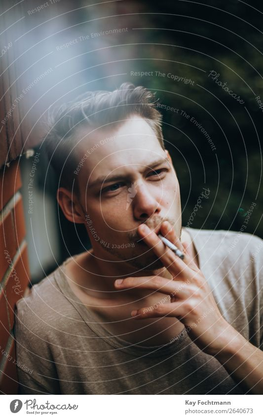 portrait of smoking man addiction adult beard casual caucasian cigarette cool face guy habit handsome health lifestyles look male masculinity outdoors person