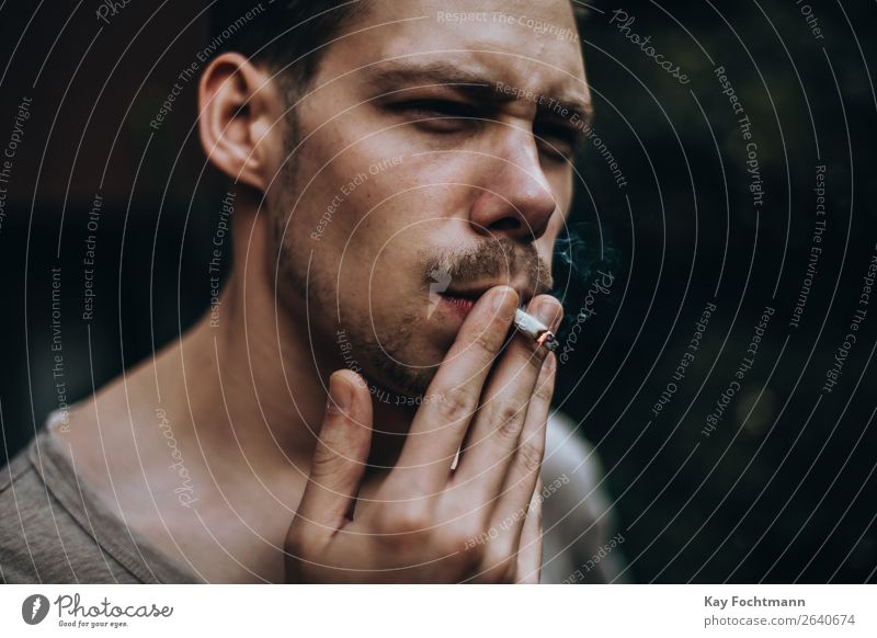 Young man pulling on a homemade cigarette Lifestyle Style Smoking Relaxation Masculine Youth (Young adults) Face 1 Human being 18 - 30 years Adults Brunette