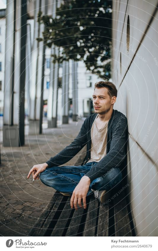 portrait of sitting man on bench addiction adult beard casual caucasian cigarette cool face guy habit handsome health lifestyles look male masculinity outdoors