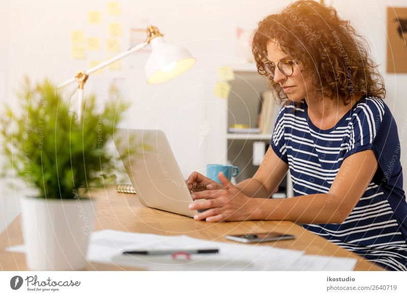Beautiful woman working at the office Design Happy Desk Success Work and employment Profession Workplace Office Business Career Computer Notebook Keyboard