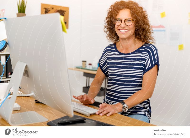 Designer working at the office Happy Desk Success Work and employment Profession Workplace Office Business Career Computer Screen Technology Human being Woman