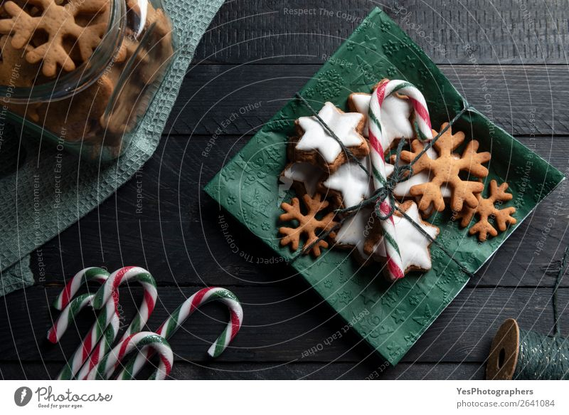 Gingerbread cookies and candy cane on a napkin. Cake Dessert Candy Feasts & Celebrations Christmas & Advent Delicious Sweet Tradition above view Bakery