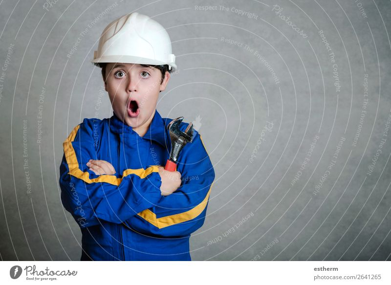 child in construction uniform Lifestyle Joy Child Work and employment Profession Construction site Tool Hammer Human being Masculine Boy (child) Infancy 1