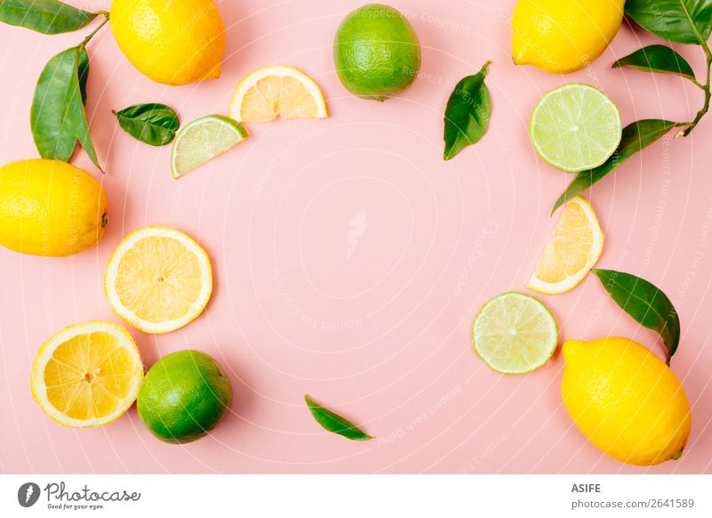 Lime and lemon frame on pink background Fruit Nutrition Beverage Lemonade Juice Summer Leaf Fresh Above Yellow Green Pink lime citrus drink food Mature colorful