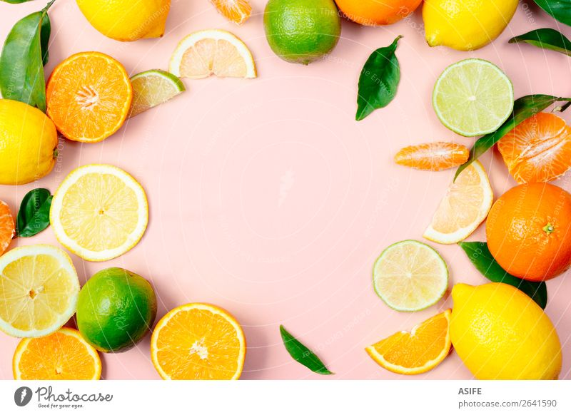 Citrus fruits frame on pink background Fruit Nutrition Beverage Lemonade Juice Summer Leaf Fresh Above Yellow Green Pink lime orange Tangerine citrus drink food