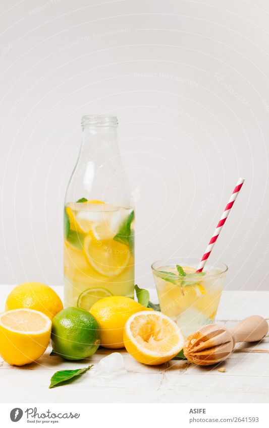 Fresh homemade lemonade on white background Fruit Diet Beverage Lemonade Juice Bottle Summer Table Leaf Wood Cool (slang) Yellow Green White lime citrus Mint