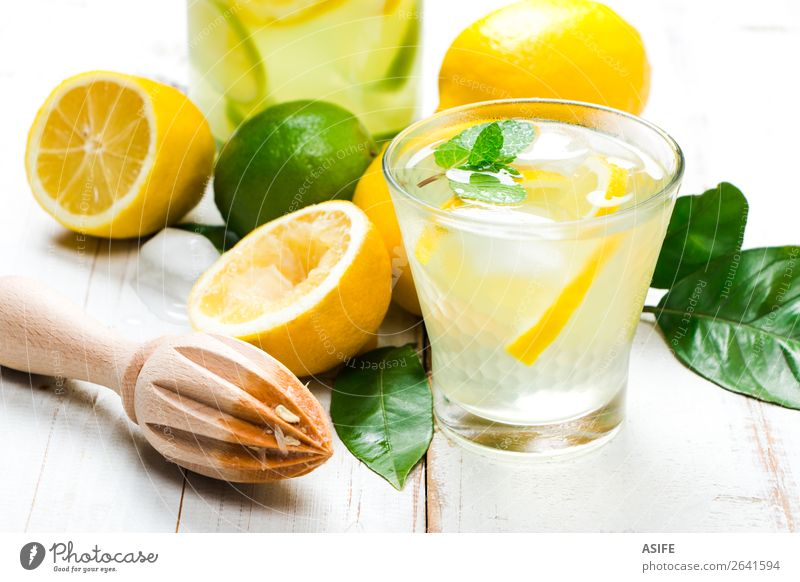 Homemade lemonade with reamer on white wooden table Fruit Diet Beverage Lemonade Juice Summer Table Leaf Wood Cool (slang) Fresh Yellow Green White lime citrus