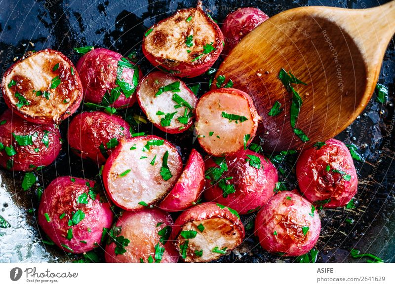 Roasted radishes in a pan Vegetable Nutrition Vegetarian diet Diet Pan Spoon Plant Wood Fresh Small Delicious Red Colour radished roasted Root cooking Wok