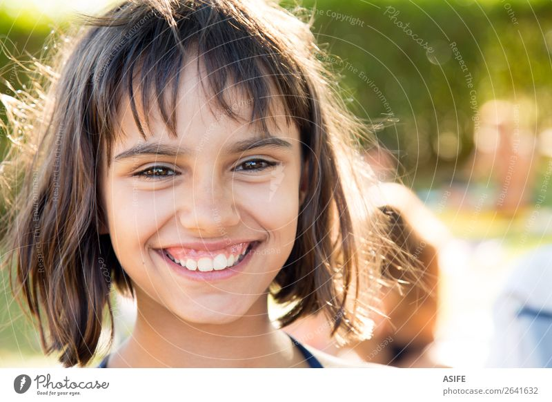 Portrait of a happy little girl smiling after swimming Lifestyle Joy Happy Beautiful Contentment Swimming pool Summer Garden Child Woman Adults Infancy Warmth