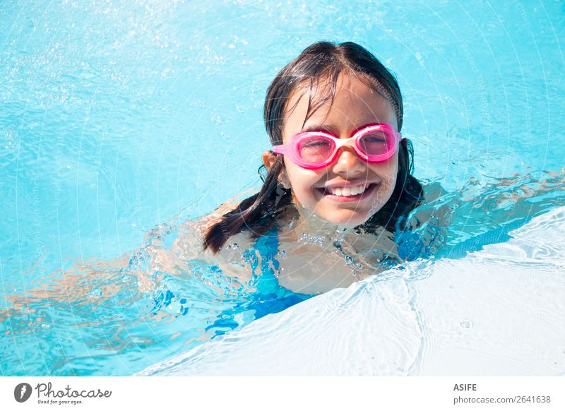 Funny little girl swimming in the pool Lifestyle Joy Happy Beautiful Relaxation Swimming pool Leisure and hobbies Playing Vacation & Travel Summer Sports Child