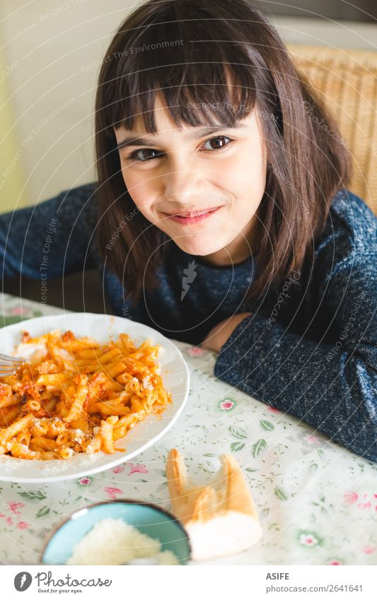 Happy little girl enjoying pasta Cheese Nutrition Eating Lunch Dinner Fork Joy Beautiful Table Kitchen Child Smiling Sit Delicious Cute Appetite Macaroni penne