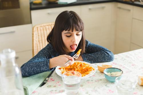 Little girl eating pasta at home Cheese Nutrition Eating Lunch Dinner Fork Joy Happy Beautiful Table Kitchen Child Sit Delicious Cute Appetite Macaroni penne