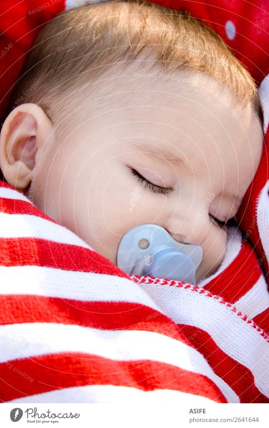 Adorable baby sleeping wrapped in a red blanket Face Life Relaxation Summer Sun Child Human being Baby Boy (child) Infancy Baby carriage Stripe Sleep Dream