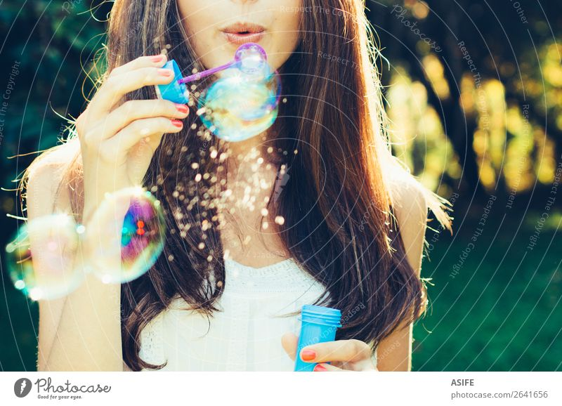 Girl blowing bubbles Joy Happy Beautiful Playing Summer Feasts & Celebrations Human being Woman Adults Lips Nature Warmth Park Dream Happiness Soft Green Soap