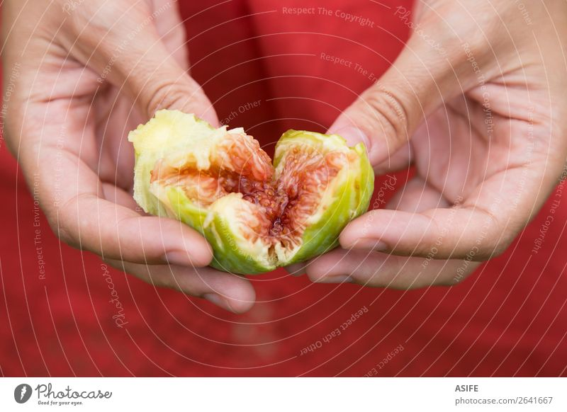 Fig heart in hands Fruit Diet Woman Adults Hand Nature Heart Fresh Juicy Green Red figs Mature food healthy sweet Organic Mediterranean fiber Hold Porcelain
