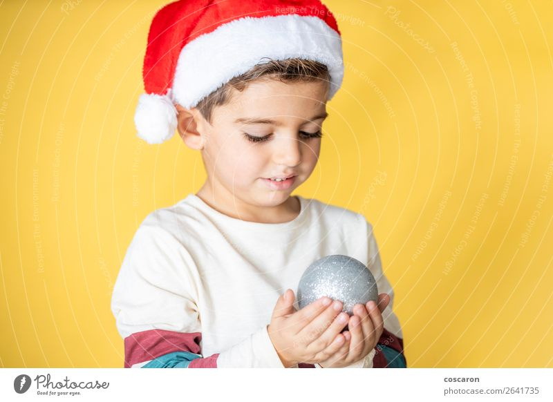 Cute kid with Santa´s hat and a Christmas ball Child Human being Vacation & Travel Christmas & Advent Beautiful Green White Red Hand Joy Winter Lifestyle Yellow