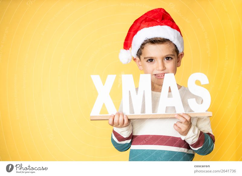 Adorable kid with Santa´s hat on Christmas day. Child Human being Christmas & Advent Colour White Red Joy Winter Lifestyle Warmth Yellow Funny Emotions Happy