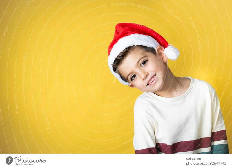Adorable kid with Santa´s hat on Christmas day. Child Human being Vacation & Travel Christmas & Advent Colour Winter Warmth Yellow Funny Happy Style
