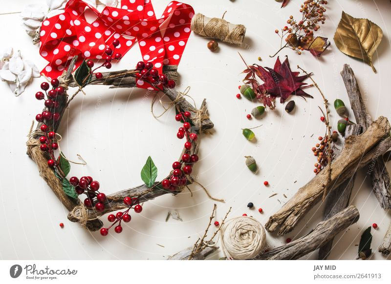 Creating a wooden wreath with christmas red barries Fruit Leisure and hobbies Winter Garden Decoration Thanksgiving Christmas & Advent New Year's Eve